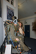 Israel, Hazirim, near Beer Sheva, Israeli Air Force museum. The national centre for Israel's aviation heritage. a female soldier instructor explaining and demonstrating on the exhibits of a model wearing a pilots flight suit