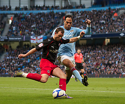 MANCHESTER, ENGLAND - Sunday, March 13, 2011: Manchester City's Joleon Lescott and Reading's Noel Hunt during the FA Cup 6th Round match at the City of Manchester Stadium. (Photo by Vergad Grott/Propaganda)