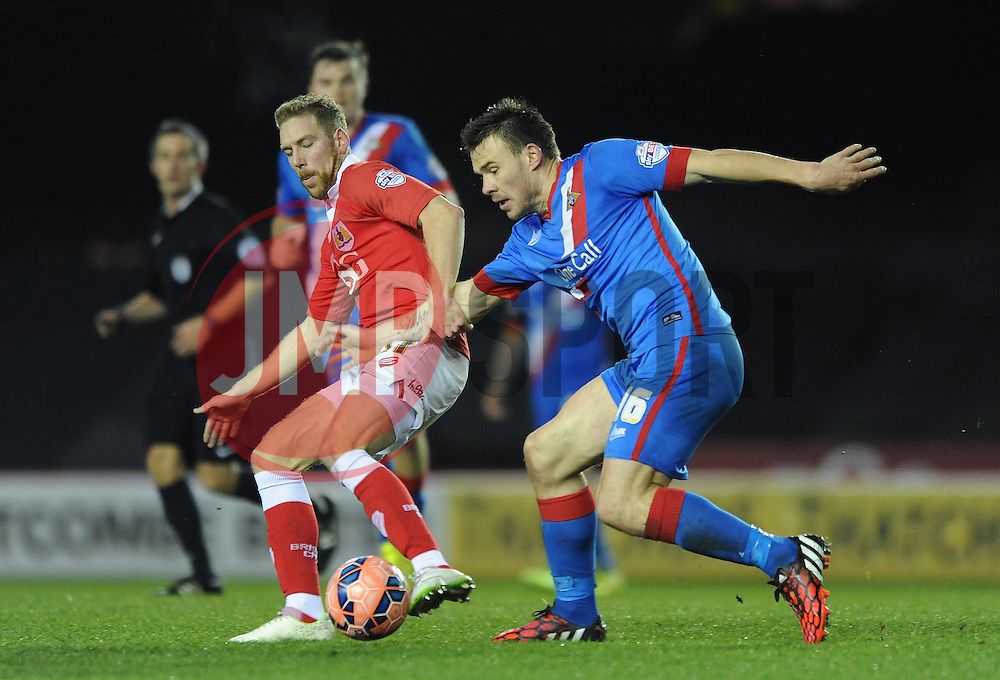 Bristol City's Scott Wagstaff jostles for the ball with Doncaster Rovers' Andrew Butler - Photo mandatory by-line: Dougie Allward/JMP - Mobile: 07966 386802 - 13/01/2015 - SPORT - Football - Bristol - Ashton Gate Stadium - Bristol City v Doncaster Rovers - FA Cup - Third Round replay