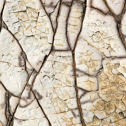 Photo of flat rock formation background with lines and cracks pattern