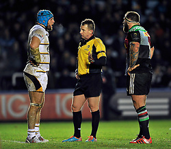 Referee Nigel Owens has a word with Wasps captain James Haskell and Harlequins captain Joe Marler - Photo mandatory by-line: Patrick Khachfe/JMP - Mobile: 07966 386802 17/01/2015 - SPORT - RUGBY UNION - London - The Twickenham Stoop - Harlequins v Wasps - European Rugby Champions Cup
