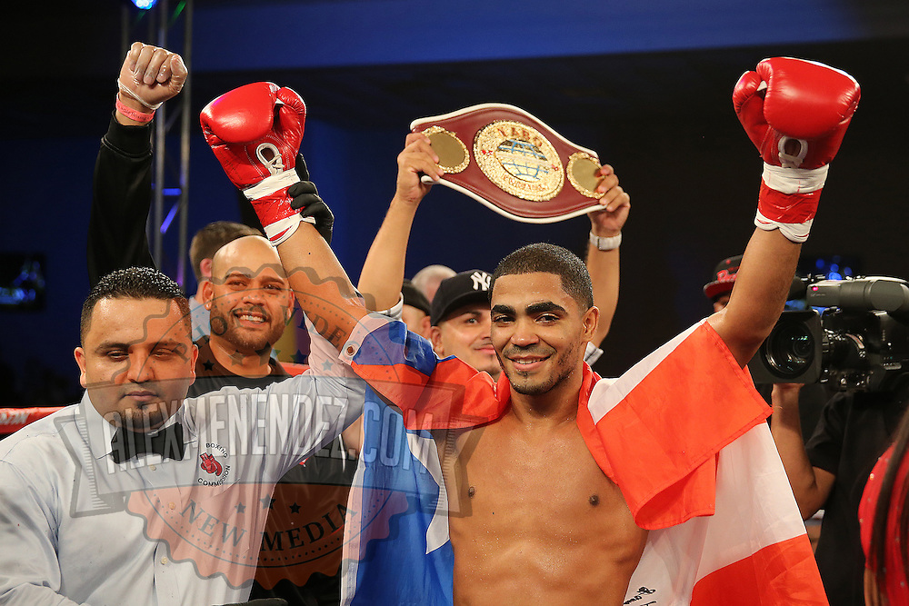 ORLANDO, FL - OCTOBER 04:  Gamalier Rodriguez celebrates his TKO win over Martin Gonzales during a professional featherweight boxing match at the Bahía Shriners Auditorium & Events Center on October 4, 2014 in Orlando, Florida.  (Photo by Alex Menendez/Getty Images) *** Local Caption *** Martin Gonzales; Gamailer Rodriguez