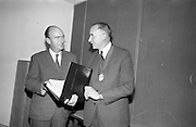3/11/1967<br /> 11/3/1967<br /> 3 November 1967<br /> <br /> Presentation of the Irish Hardware Associations Postal Course to Junior Assistants was made to the Minister of Labour Dr. P. J. Hillery T.D. at the Dept. of Labour in Dublin.<br /> <br /> Picture shows Mr. Charles M. Wilson Vice President of the Irish Hardware Association looking over the course with the Minister