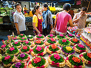 "24 NOVEMBER 2015 - BANGKOK, THAILAND:  People shop for ""krathongs"" in Bang Chak Market. Krathongs are small boats Thais float in canals and bodies of water, on Loy Krathong, a Buddhist holiday on the full moon in November.  The Bang Chak Market serves the community around Sois 91-97 on Sukhumvit Road in the Bangkok suburbs. About half of the market has been torn down. Bangkok city authorities put up notices in late November that the market would be closed by January 1, 2016 and redevelopment would start shortly after that. Market vendors said condominiums are being built on the land.        PHOTO BY JACK KURTZ"