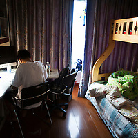 BEIJING, OCT.18, 2014 : Song Yonglin, 14, reviews his studies after he gets up early on a Saturday morning. He spends every weekend taking extra school lessons in order to improve his scores which cost his parents about 4-5000 Yuan/month. He would like to switch to the International school in Beijing  and study economics later on in the US.