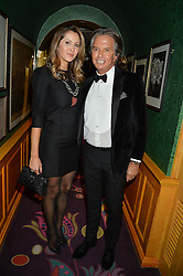 RICHARD CARING and PATRICIA MONDINNI at a dinner to celebrate the 125th anniversary of the Dog's Trust held at Annabel's, Berkeley Square, London on 1st November 2016.