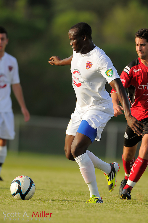 Orlando City forward Moses Aduny (9) during Orlando City's 2-1 win over Laredo Heat in their PDL Southern Conference Championships playoff game at Trinity Catholic High Schooll on July 20, 2012 in Ocala, Florida. ..©2012 Scott A. Miller