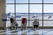 Philadelphia, Pennsylvania - People sit in rocking chairs while waiting for their flights at Philadelphia International Airport on Jan. 26, 2013.