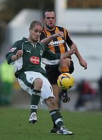 Photo: Lee Earle.<br /> Plymouth Argyle v Hull City. Coca Cola Championship. 09/12/2006. Hull's Stuart Elliott (R) battles with Marcel Seip.