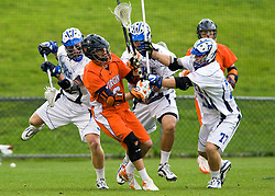 Duke defenseman Nick O'Hara (77) knocks the ball away from Virginia attackman Ben Rubeor (6).  The #2 ranked Duke Blue Devils defeated the #3 ranked Virginia Cavaliers 11-9 in the finals of the Men's 2008 Atlantic Coast Conference tournament at the University of Virginia's Klockner Stadium in Charlottesville, VA on April 27, 2008.
