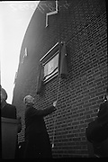 Unveiling of Plaque at Boland's Mills. President Eamon de Valera unveils a plaque to commemorate the 1916 Rising at Bolands Mills, where he was Commandant during the insurrection.<br />