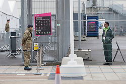 © licensed to London News Pictures. London, UK 20/07/2012. Soldiers and a G4S security staff (right) guarding entrances of the Olympic site on 20/07/12. Photo credit: Tolga Akmen/LNP