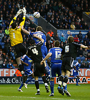 Photo: Steve Bond/Richard Lane Photography. Leicester City v Peterborough United. Coca-Cola Football League One. 20/12/2008. Keeper Joe Lewis jumps to take a cross as Steve Howard pressures