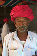Portrait of a rajput in red turban.