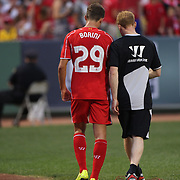 Fabio Borini, Liverpool, leaves the field injured during the Liverpool Vs AS Roma friendly pre season football match at Fenway Park, Boston. USA. 23rd July 2014. Photo Tim Clayton