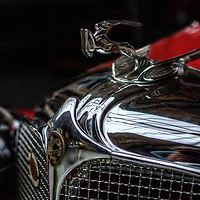 Close up of classic car with chrome emblem