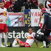 Tim Cahill, (centre), New York Red Bulls, injured as team mates Armando, (left), and Roy Miller, summon the trainer. Cahill left the match in the 27th minute during the New York Red Bulls V Chivas USA, Major League Soccer regular season match at Red Bull Arena, Harrison, New Jersey. USA. 30th March 2014. Photo Tim Clayton