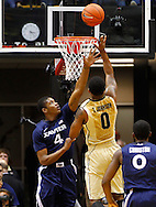 WEST LAFAYETTE, IN - DECEMBER 01: Travis Taylor #4 of the Xavier Musketeers tries to defend the shot of Terone Johnson #0 of the Purdue Boilermakers at Mackey Arena on December 1, 2012 in West Lafayette, Indiana. Xavier defeated Purdue 63-57. (Photo by Michael Hickey/Getty Images) *** Local Caption *** Travis Taylor; Terone Johnson
