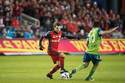December 9, 2017 - Toronto, Ontario, Canada - Toronto FC forward SEBASTIAN GIOVINCO (10) dribbles the ball past Seattle Sounders midfielder NICOLAS LODEIRO (10) during the MLS Cup championship match at BMO Field in Toronto, Canada.  Toronto FC defeats Seattle Sounders 2 to 0. (Credit Image: © Mark Smith via ZUMA Wire)