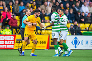 Ricki Lamie (#5) of Livingston FC is led away by referee Willie Collum as he attempts to confront the Celtic players during the Ladbrokes Scottish Premiership match between Livingston FC and Celtic FC at The Tony Macaroni Arena, Livingston, Scotland on 6 October 2019.