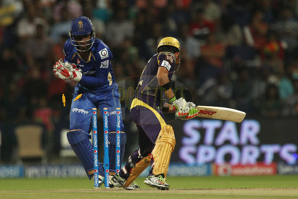 Sanju Samson of the Rajatshan Royals tries to stump Gautam Gambhir captain of the Kolkata Knight Riders during match 19 of the Pepsi Indian Premier League 2014 Season between The Kolkata Knight Riders and the Rajasthan Royals held at the Sheikh Zayed Stadium, Abu Dhabi, United Arab Emirates on the 29th April 2014<br /> <br /> Photo by Ron Gaunt / IPL / SPORTZPICS