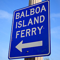 Photo of Balboa Island Ferry sign in Newport Beach California. The Balboa Island Ferry has been operating since 1919 and carries people and cars from Balboa Peninsula to Balboa Island across Newport Harbor (Newport Bay).