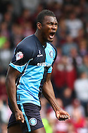 Aaron Pierre of Wycombe Wanderers celebrates scoring his team's first goal to make it 1-1 during the Sky Bet League 2 match at Adams Park, High Wycombe<br /> Picture by David Horn/Focus Images Ltd +44 7545 970036<br /> 18/04/2014
