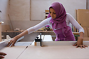 A woman learns new skills through the a NHASD Program, in Egypt. Women are taught vocational and practical skills, such as, baking, teaching and carpentry. This gives them the opportunity to earn money in the future, which is crucial as poverty is becoming more widespread in rural areas of Upper Egypt, and especially and among female-headed households.