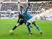 Football - 2019 / 2020 Premier League - Newcastle United vs. Manchester City<br /> <br /> Benjamin Mendy of Manchester City vies with Javier Manquillo of Newcastle United , at St James' Park.<br /> <br /> COLORSPORT/BRUCE WHITE