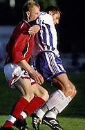 03.06.2000 Daugava Stadium, Riga, Latvia. .Friendly match Latvia v Finland. .Shefki Kuqi (Finland) v Igors Stepanovs (Latvia).©JUHA TAMMINEN