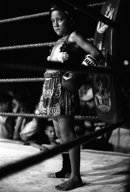 No matter what the age, Young Muay Thai kickboxers are expected to give it their all at a small make-shift arena just outside Bangkok, Thailand..March 2003.©David Dare Parker /AsiaWorks Photography