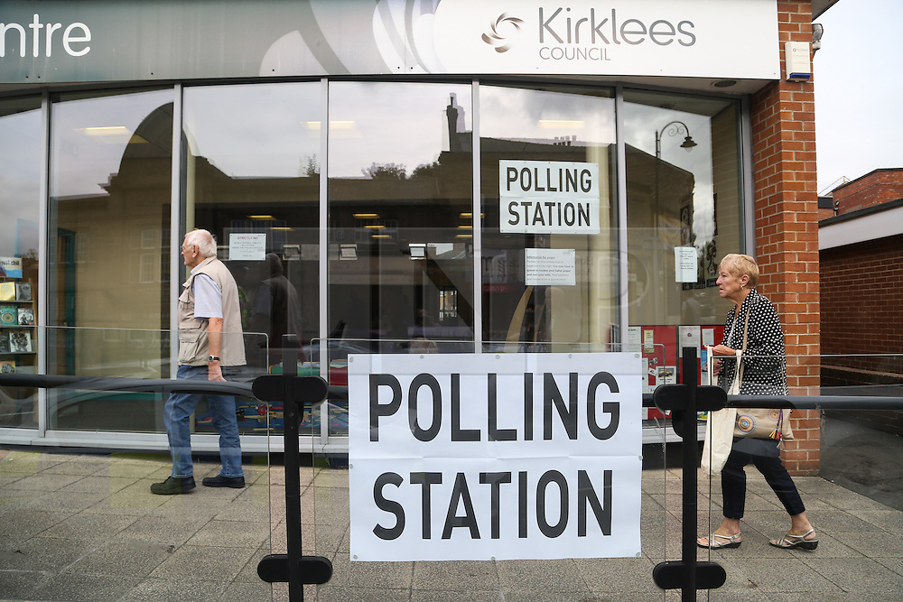 © Licensed to London News Pictures. 23/06/2016. Birstall, UK. Birstall Library in West Yorkshire opens as a polling station for the EU referendum this morning. Labour MP Jo Cox  was stabbed and killed outside the library a week ago today. Jo, who was only elected to the constituency of Batley and Spen in West Yorkshire last year, was shot and killed in the town last week. Tommy Mair has been charged with her murder. Photo credit : Ian Hinchliffe/LNP