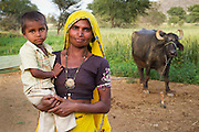 Rural Indian woman with child and cow. Portrait photography by Debbie Zimelman, Modiin, Israel