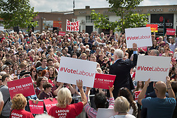 © Licensed to London News Pictures. 31/05/2017. Reading, UK. Leader of the Labour Party JEREMY CORBYN holds up a 'Vote Labour' placard during a rally at Rivermead Leisure Centre in Reading, Berkshire, ahead of a general election on June 8. Mr Corbyn has announced that he will join an seven way election debate tonight in Cambridge. Prime Minister Theresa May has said she will not attend. Photo credit: Peter Macdiarmid/LNP