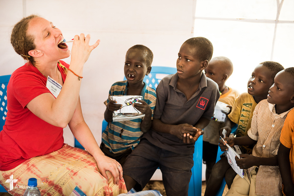Nicole Boeder, a teacher and a member of Trinity Lutheran Church, Springfield, Ill., teaches children how to brush their teeth during the LCMS Mercy Medical Team on Tuesday, June 21, 2016, in Nataparkakono, a village in Turkana, Kenya.  LCMS Communications/Erik M. Lunsford