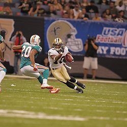 2008 August 28: Return specialist, Skyler Green (10) of the New Orleans Saints returns a punt as Chris Crocker (20) of the Miami Dolphins pursues during a preseason contest at the Louisiana Superdome in New Orleans, LA.