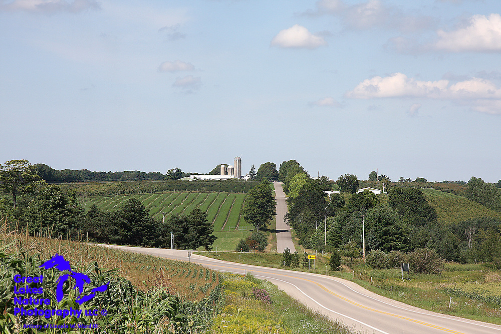 While the northern portion of Michigan's Lower Peninsula is heavily forested, and includes some genuine wilderness areas, it also contains some of the most beautiful agricultural settings in the state. This farm scene, captured in the rolling hills of Antrim County, is an excellent example.