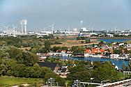 Nederland, Halfweg, 29 aug 2013<br /> Uitzicht vanaf de voormalige suikersilo's bij Halfweg op het dorp Halfweg. <br /> Op de achtergrond het westelijk industriegebied van Amsterdam Westpoort.<br /> <br /> Foto(c): Michiel Wijnbergh
