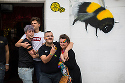 © Licensed to London News Pictures . 25/08/2017. Manchester , UK. People on Canal Street in Manchester's Gay Village on the opening night of Manchester Pride's Big Weekend . The annual festival , which is the largest of its type in Europe , celebrates LGBT life . Photo credit: Joel Goodman/LNP