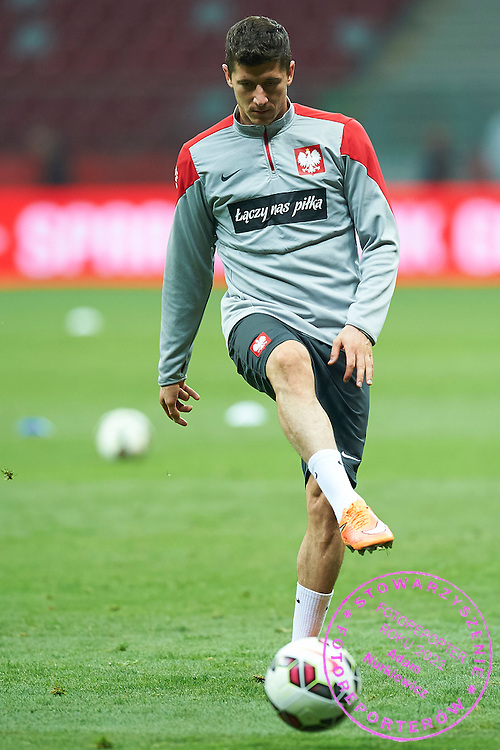 Poland's Robert Lewandowski kicks the ball while warm-up during official training one day before the EURO 2016 qualifying match between Poland and Germany on October 10, 2014 at the National stadium in Warsaw, Poland<br /> <br /> Picture also available in RAW (NEF) or TIFF format on special request.<br /> <br /> For editorial use only. Any commercial or promotional use requires permission.<br /> <br /> Mandatory credit:<br /> Photo by &copy; Adam Nurkiewicz / Mediasport