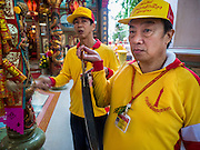 "23 JUNE 2015 - MAHACHAI, SAMUT SAKHON, THAILAND:  Men bang prayer gongs at the beginning of the procession for the City Pillar Shrine in Mahachai. The Chaopho Lak Mueang Procession (City Pillar Shrine Procession) is a religious festival that takes place in June in front of city hall in Mahachai. The ""Chaopho Lak Mueang"" is  placed on a fishing boat and taken across the Tha Chin River from Talat Maha Chai to Tha Chalom in the area of Wat Suwannaram and then paraded through the community before returning to the temple in Mahachai.  PHOTO BY JACK KURTZ"