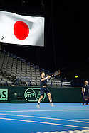 Britain's Andy Murray pictured beneath a huge Japan flag on Davis Cup Practise Day at Birmingham Indoor Arena, Birmingham<br /> Picture by Anthony Stanley/Focus Images Ltd 07833 396363<br /> 03/03/2016