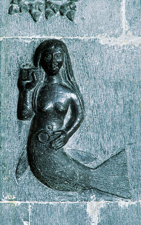 Stone carving of mermaid on 15th C. chancel arch inside Clonfert Cathedral, County Galway, Ireland. Founded by Saint Brendan.