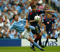 Photo Aidan Ellis.<br />Manchester City v Portsmouth.<br />FA Barclaycard Premiership.<br />23/08/2003.<br />City's Robbie Fowler and Pompey's Degan Stefanovic