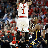 CHICAGO, IL - APR 18: Derrick Rose #1 of the Chicago Bulls shoots the ball against Paul George #24 of the Indiana Pacers during game 2 of the Eastern Conference First Round at the United Center on April 18, 2011 in Chicago, IL. NOTE TO USER: User expressly acknowledges and agrees that, by downloading and or using this photograph, User is consenting to the terms and conditions of the Getty Images License Agreement. Mandatory Credit: 2011 NBAE (Photo by Chris Elise/NBAE via Getty Images)