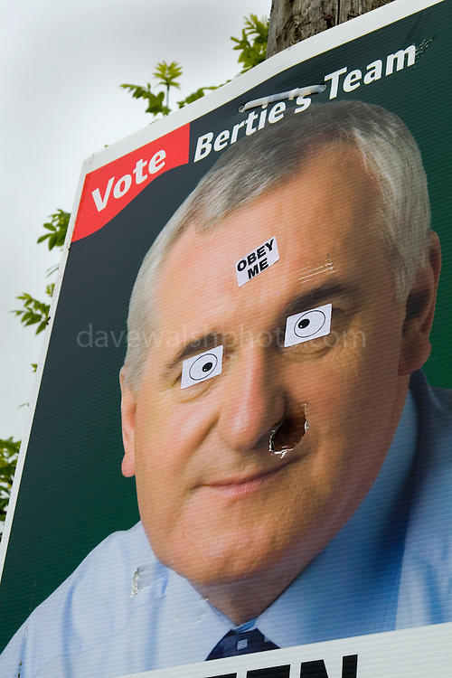 "Defaced Fianna Fail election poster in  Ennistymon altered with stickers saying: ""Obey Me"".."
