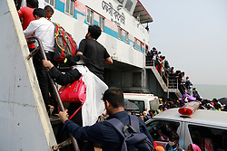 Bangladeshi garments workers try to get on board of a over crowed ferry as they returning to their village homes at the Shimulia ferry terminal in Mawa, near Dhaka, Bangladesh, April 05, 2020. Thousands of readymade garment workers from across the country had either walked or used alternative modes of transpiration to reach capital Dhaka over the past few days, as owners decided to open the factories amid a government-enforced soft shutdown to prevent the novel coronavirus from spreading further. But following harsh criticisms, BGMEA was forced to keep the factories closed until April 11. The workers were told to go back home when they went to the factories to join work on Sunday morning. Photo by Suvra Kanti Das/ABACAPRESS.COM