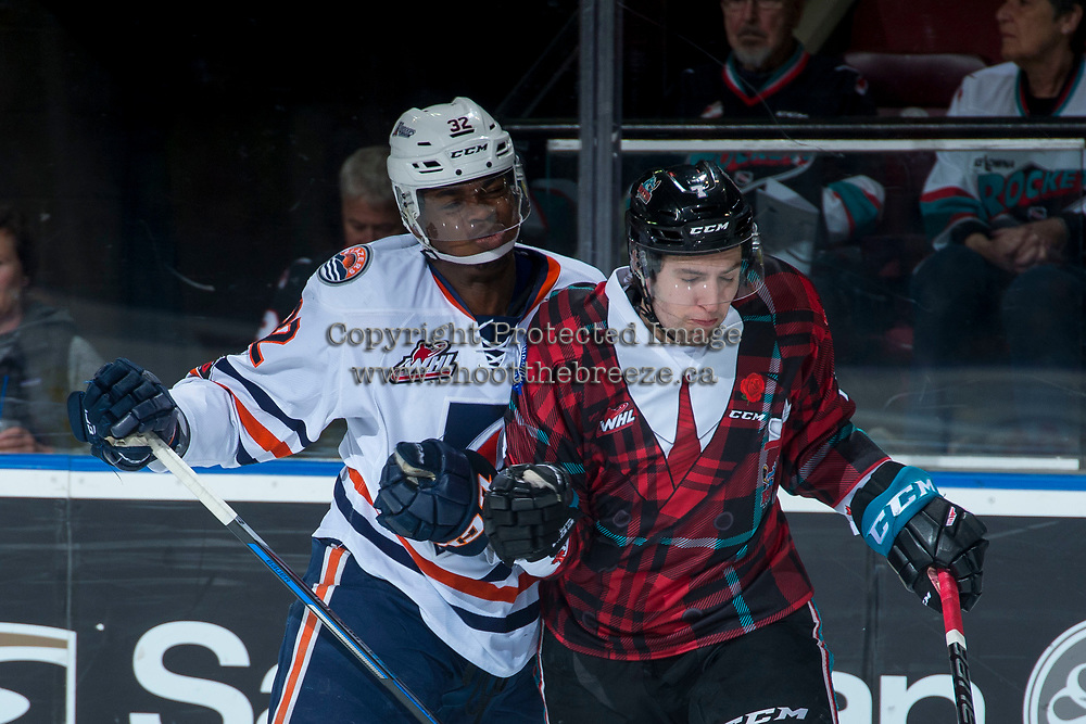 KELOWNA, CANADA - MARCH 10: Jermaine Loewen #32 of the Kamloops Blazers checks Libor Zabransky #7 of the Kelowna Rockets during first period on March 10, 2018 at Prospera Place in Kelowna, British Columbia, Canada.  (Photo by Marissa Baecker/Shoot the Breeze)  *** Local Caption ***