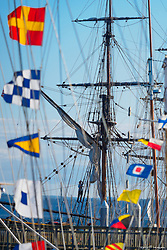 North America, United States, Washington, Port Townsend. Maritime flags on sailboat at a pier.