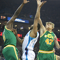 Feb 17, 2010; New Orleans, LA, USA; Utah Jazz guard Ronnie Brewer (9) and forward Andrei Kirilenko (47) defend against a shot by New Orleans Hornets guard Morris Peterson (24) during the first quarter at the New Orleans Arena. Mandatory Credit: Derick E. Hingle-US PRESSWIRE